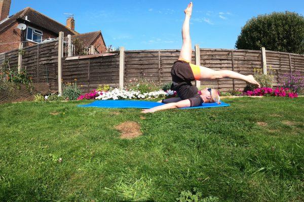 Pilates roll over with leg split